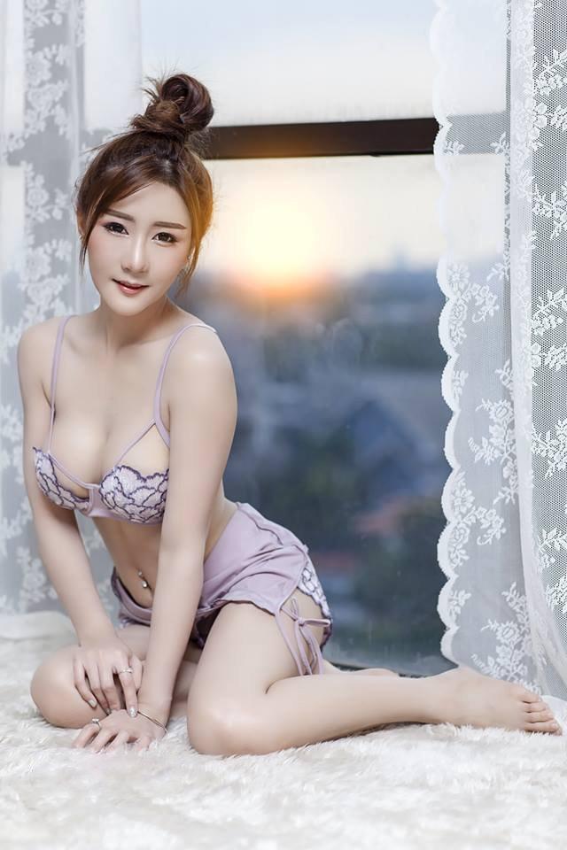 cool Asian girl wearing violet lingerie
